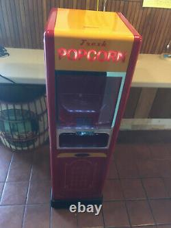Vintage Popcorn Machine withside storage, measuring scoop, and popcorn containers